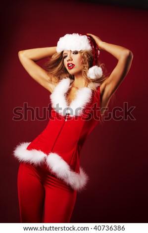 Sexy santa helper on red background - stock photo