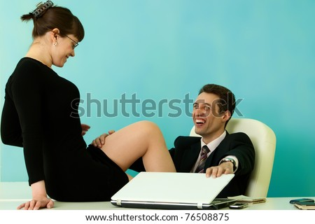 Sexy secretary and her laughing boss in office - stock photo