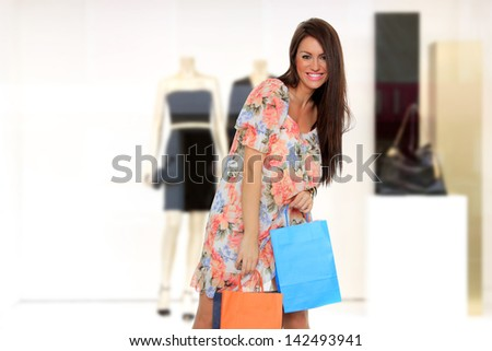 Sexy shopping woman holding bags - stock photo