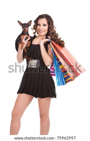 sexy shopping woman with dog, modern shopper, isolated on white background - stock photo