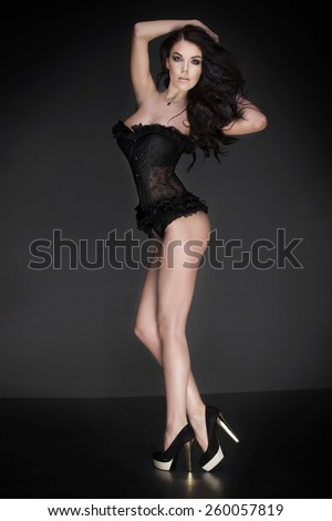 Sexy slim brunette woman posing in lingerie. - stock photo