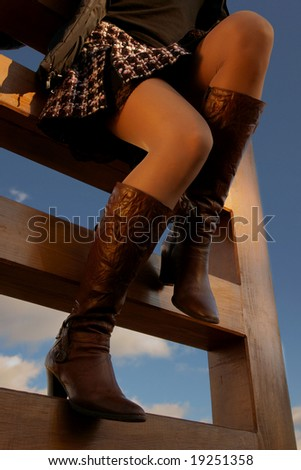 sexy slim legs on the stairs to sky - stock photo