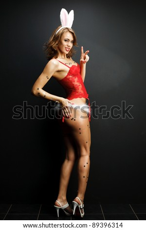 Sexy smile bunny girl - stock photo