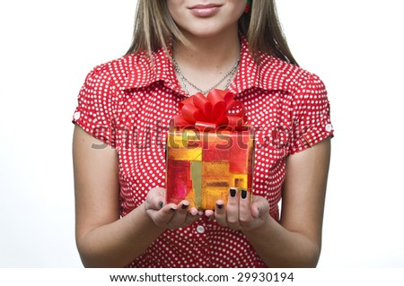 Sexy smiling girl holding a gift, focus on gift - stock photo