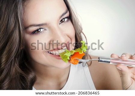 sexy smiling woman eating salad - stock photo
