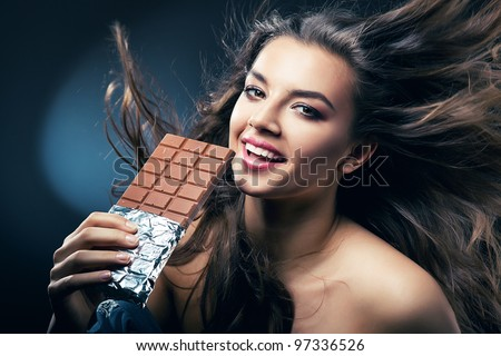 sexy smiling woman with chocolate and desire - stock photo