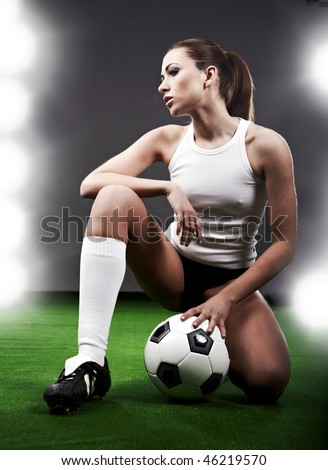 Sexy soccer player, woman on playing field