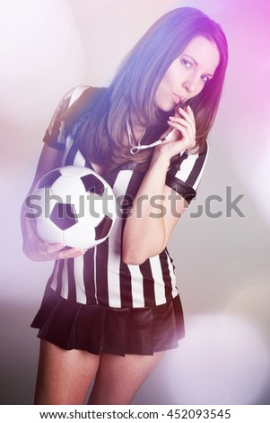 Sexy soccer referee girl holding ball - stock photo