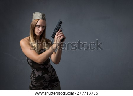 sexy soldier with gun, empty background - stock photo