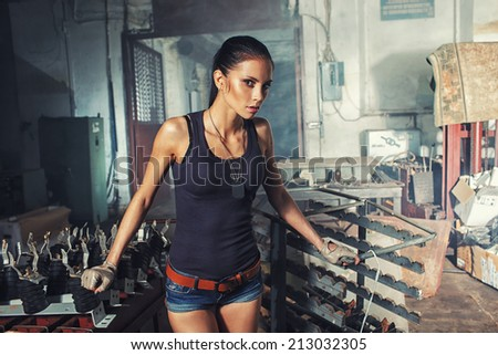 sexy soldier woman on factory ruins, action movie theme - stock photo