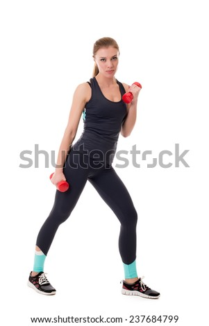 Sexy sportswoman exercising with dumbbells