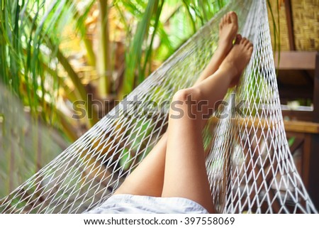 Sexy sporty woman legs in hammock.Vacation concept - stock photo