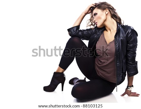 Sexy sporty woman siting on the floor on white background - stock photo