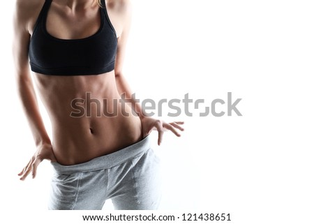 Sexy sporty woman with slim stomach over a white background - stock photo