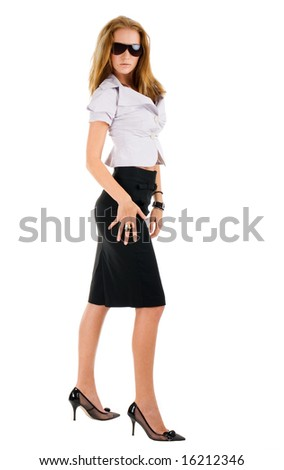 Sexy standing young woman in stylish sunglasses and black dress - stock photo