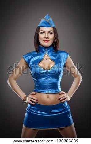 sexy stewardess in blue uniform studio shot - stock photo