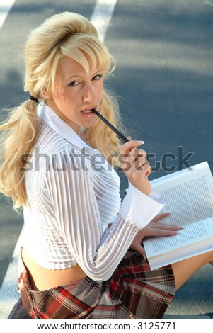 sexy student with pen in mouth - stock photo
