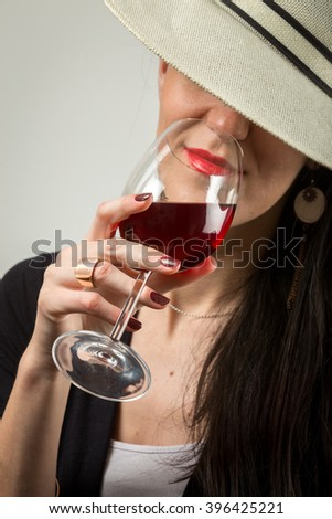 Sexy stylish lady with a glass of red wine. - stock photo