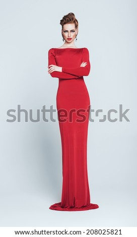 sexy tall woman in long red dress - stock photo