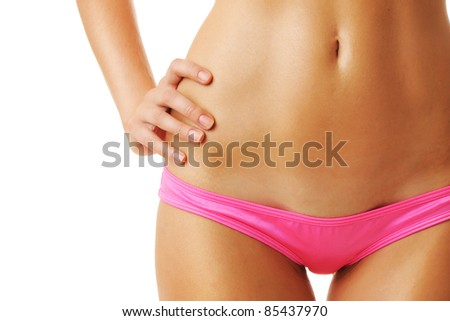 Sexy tan woman in bikini close-up isolated on white background - stock photo