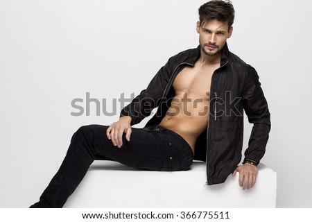 Sexy undress athletic model posing   - stock photo