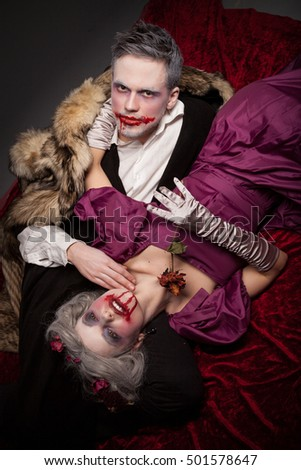 Sexy vampire couple in the dark