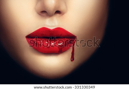 Sexy Vampire Woman lips with dripping blood. Fashion Glamour Halloween art design. Closeup of glamourous girl vampire mouth - stock photo