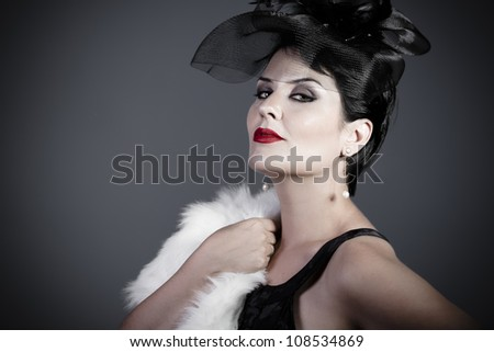 Sexy Widow on gray background, beautiful woman with black veil