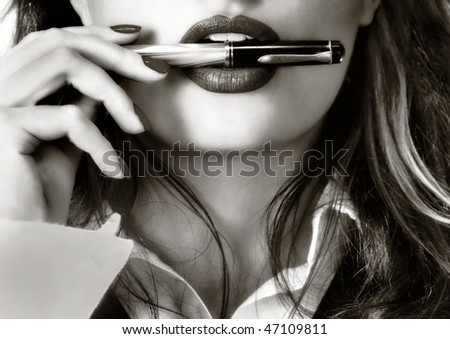 Sexy woman and a fountain pen - stock photo