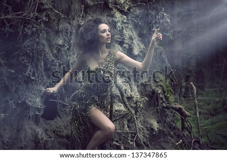 Sexy woman as a part of tree - stock photo