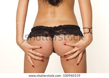Sexy woman ass in lingerie on white isolated background - stock photo