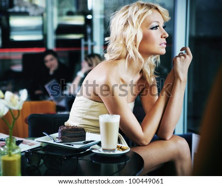 Sexy woman at a restaurant - stock photo