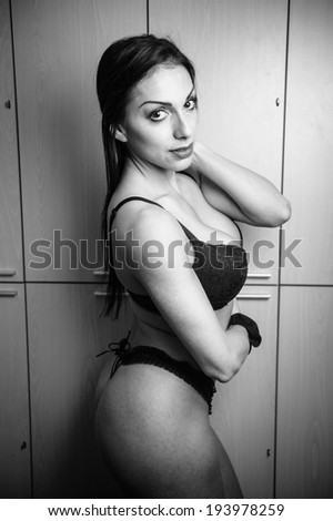 sexy woman at lockers room black and white - stock photo