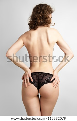 Sexy woman back on the grey background. - stock photo