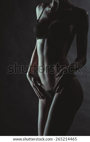 Sexy Woman Body. Lacy Underwear Lingeries. Low Key Dark Fashion Photoshoot - stock photo