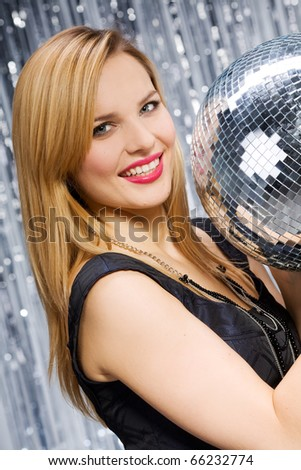 Sexy woman dancing on silver background - stock photo