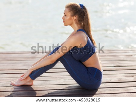 Sexy woman doing sports exercises - stock photo