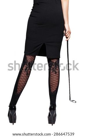 Sexy woman dominatrix body in long skirt with whip, isolated - stock photo