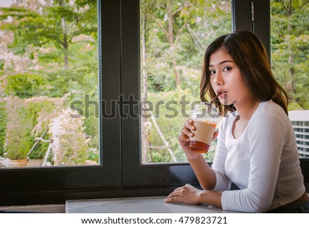 Sexy woman drinking Lemon ice tea in cafe