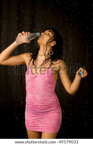 Sexy woman drinking water - stock photo