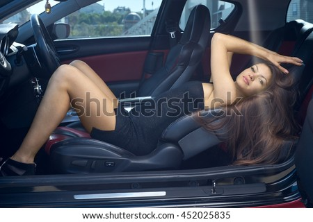 sexy woman driving a car