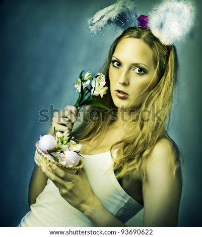 Sexy woman - easter bunny with little basket of eggs