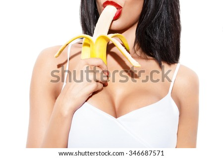 Sexy woman eating banana, isolated on white - stock photo