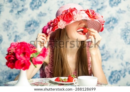 Sexy woman eating strawberry in restaurant on vacation. Sensual red Lips. red manicure and lipstick. Desire - stock photo