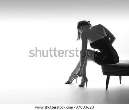 Sexy woman from back, legs, high heel shoes, white background - stock photo