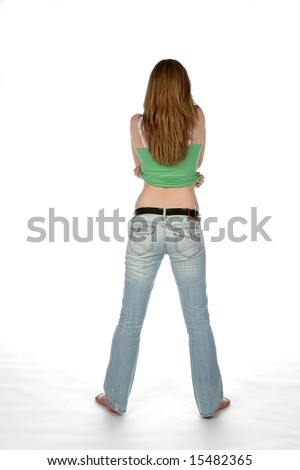 sexy woman from behind, lifting her shirt - stock photo