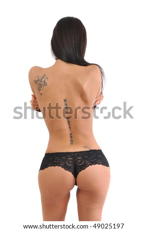 Sexy woman from behind, naked back with tattoos. - stock photo