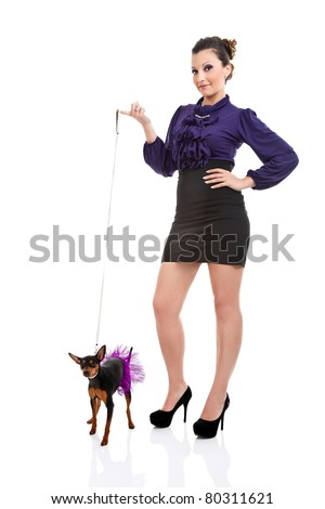 sexy woman holding on leash her little fashion dog, isolated on white background - stock photo