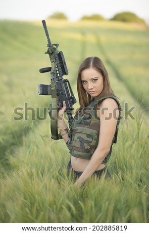 sexy woman holding up her weapon  - stock photo