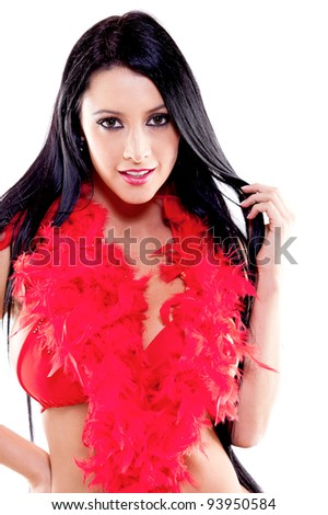 Sexy woman in a red bikini and a feather boa - isolated over a white background - stock photo